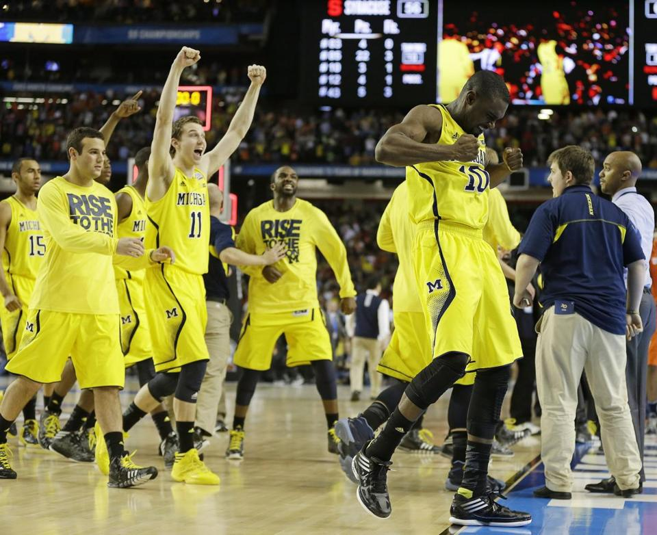 Michigan players reacted after winning the semifinal game against Syracuse.