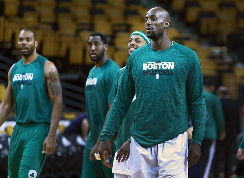 Kevin Garnett (right) and Paul Pierce (behind Garnett) are pictured on the floor two hours before the start of the game.