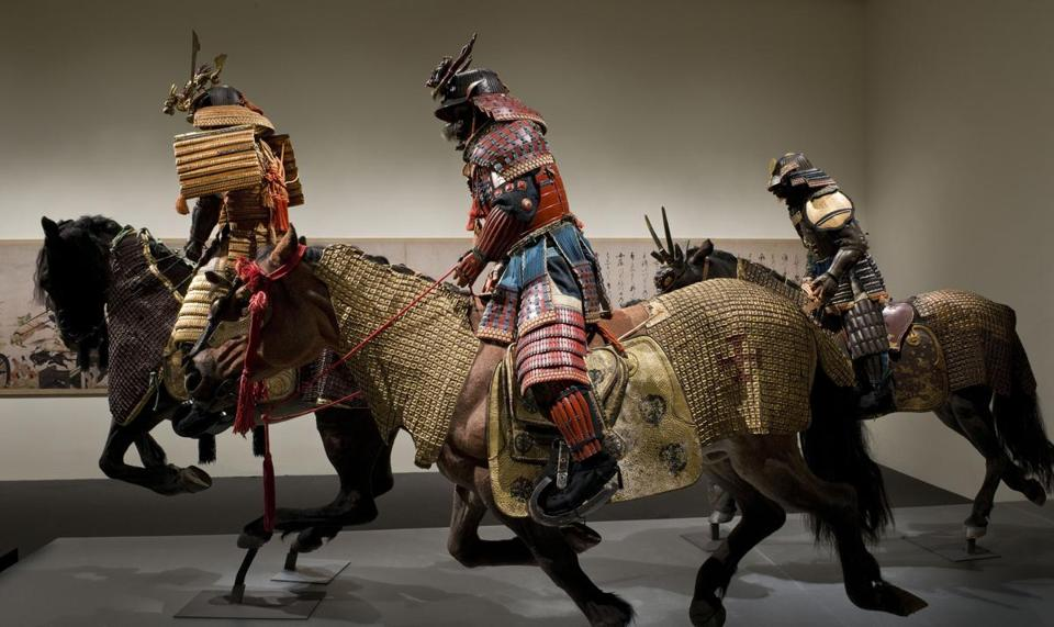 Samurai warriors on horses made of fiberglass and steel.