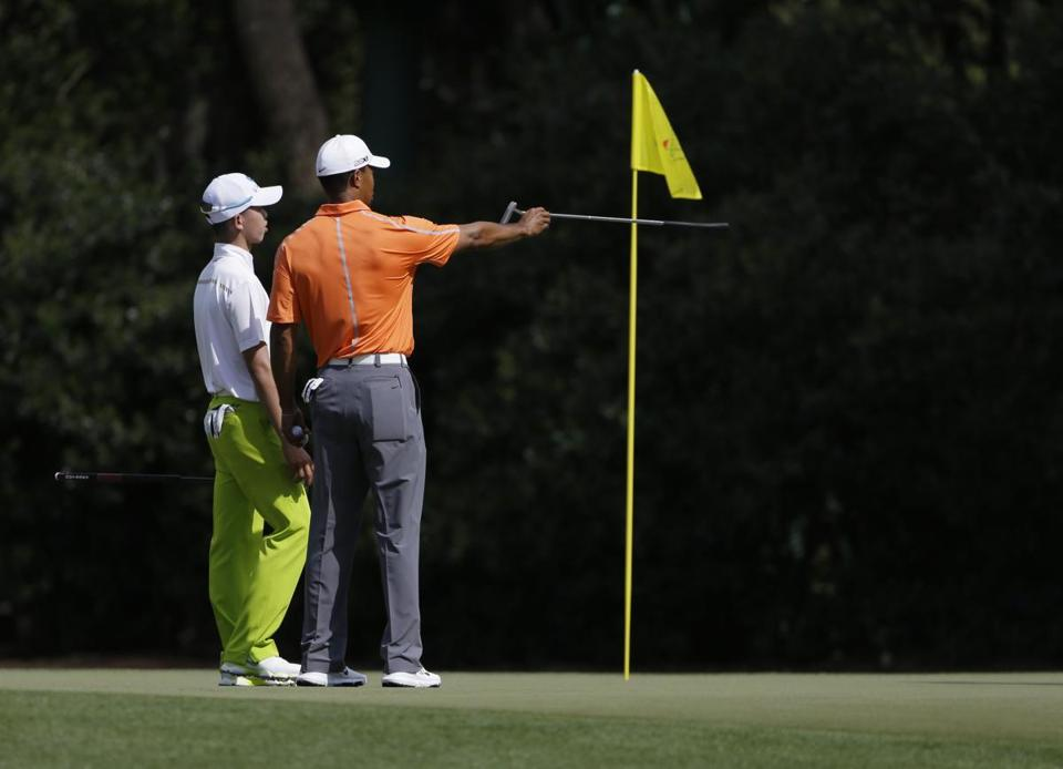 Tianlang Guan (left) quickly got a taste of the big time, playing a practice round Monday with Tiger Woods.