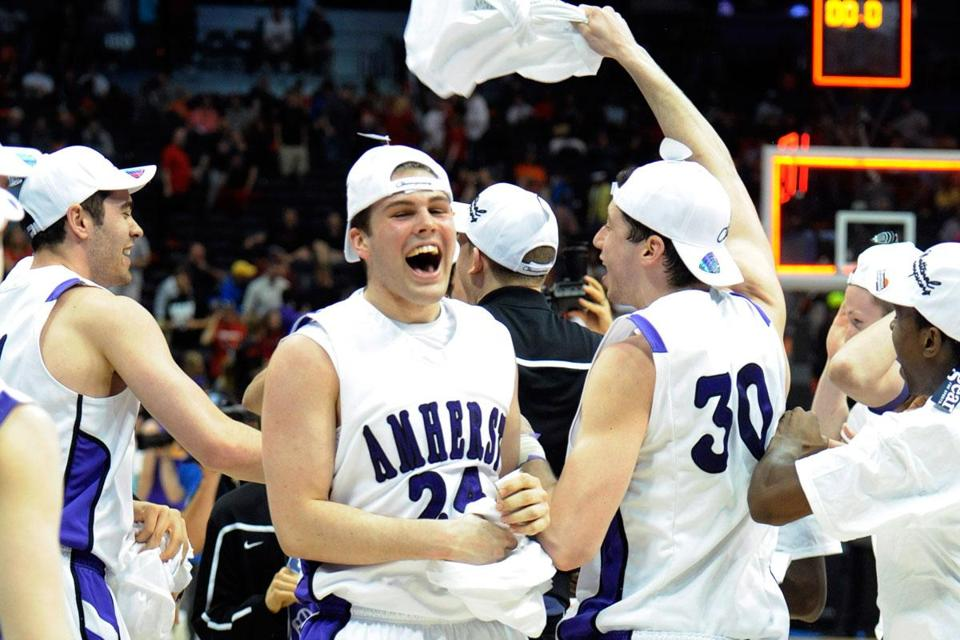 Connor Green (24), Ben Pollack (30), and their Amherst teammates start the party after a convincing win in the national championship game in Atlanta.