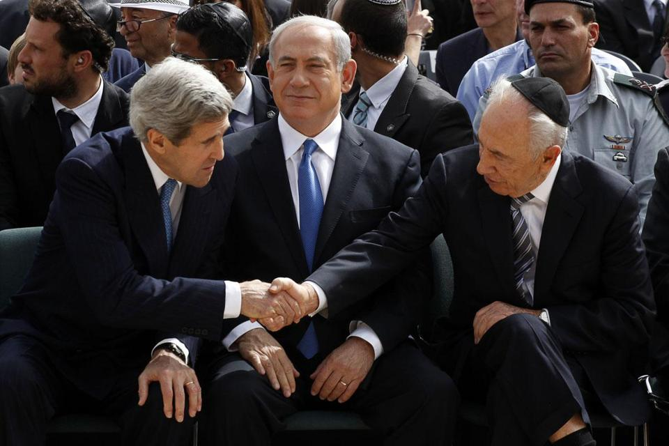 John Kerry attended a Holocaust Remembrance Day ceremony with Israeli Prime Minister Benjamin Netanyahu (middle) and President Shimon Peres.