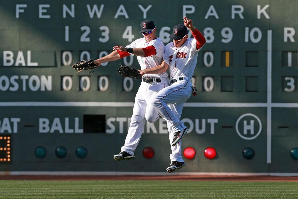 With a home-opening victory in their hip pocket, Red Sox center fielder Jacoby Ellsbury (right) does a celebratory leap with Daniel Nava, whose three-run homer was the difference.