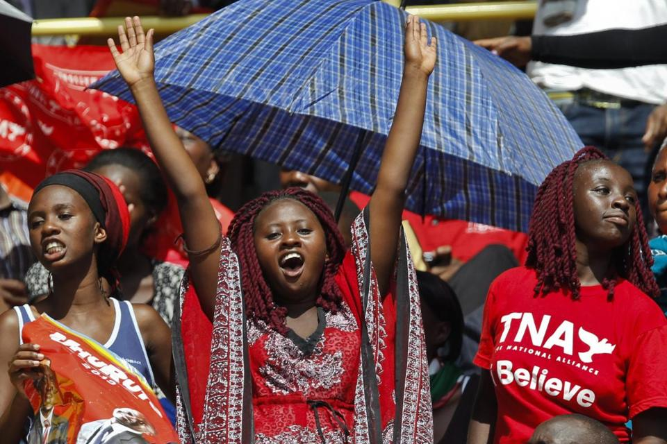 Crowds cheered during the inauguration ceremony of Kenya's president, Uhuru Kenyatta, in Kasarani, on the outskirts of Nairobi Tuesday. Kenyatta faces charges of crimes against humanity for his alleged role in electoral vilence in 2007.