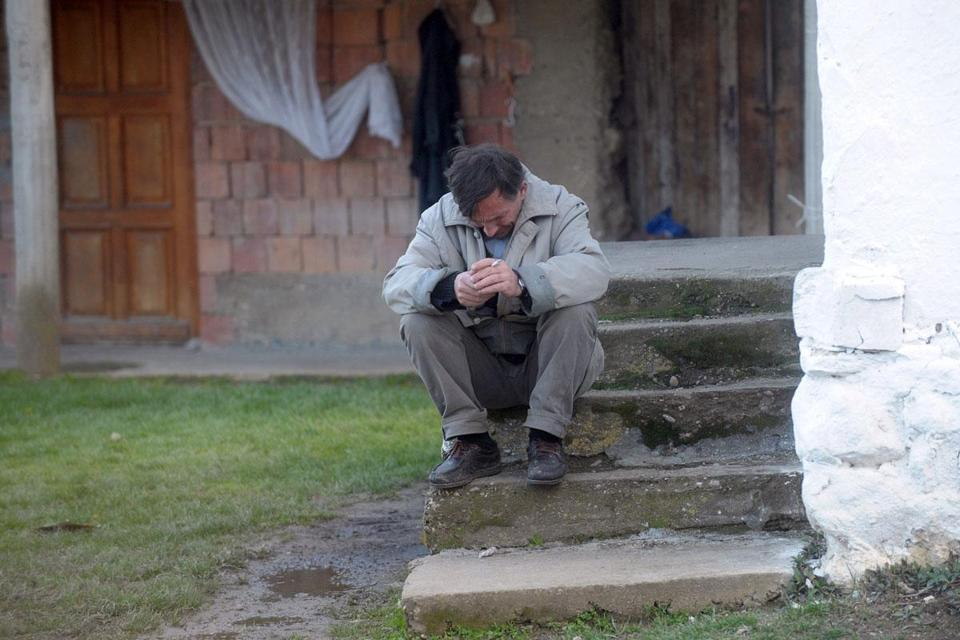 A relative of a shooting victim was overcome in the village of Velika Ivanca, Serbia, on Tuesday.