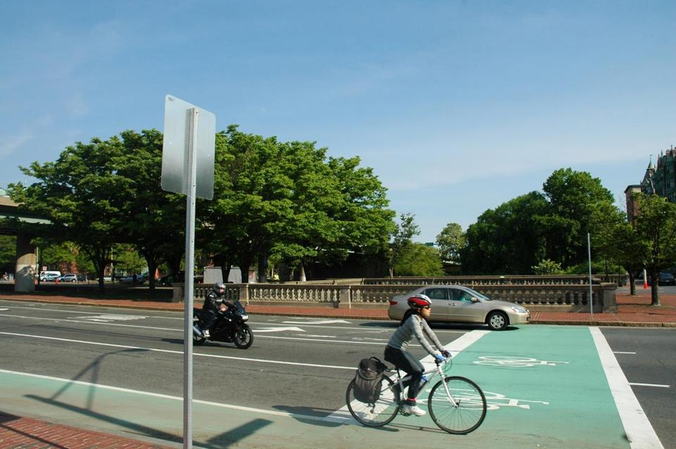 Bike boxes painted on the road at intersections provide a visible place for cyclists to wait for lights, ahead of the vehicles, essentially legitimizing the practice of cutting in line.
