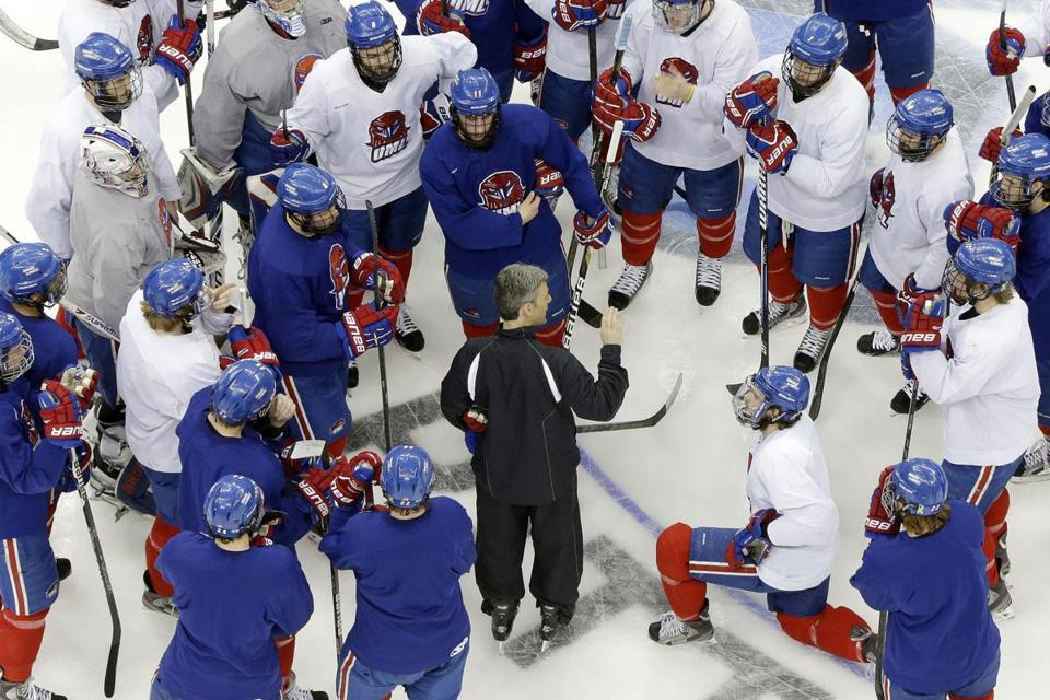 UMass-Lowell coach Norm Bazin has his players' attention as they prepare for Thursday's Frozen Four semifinal against Yale.