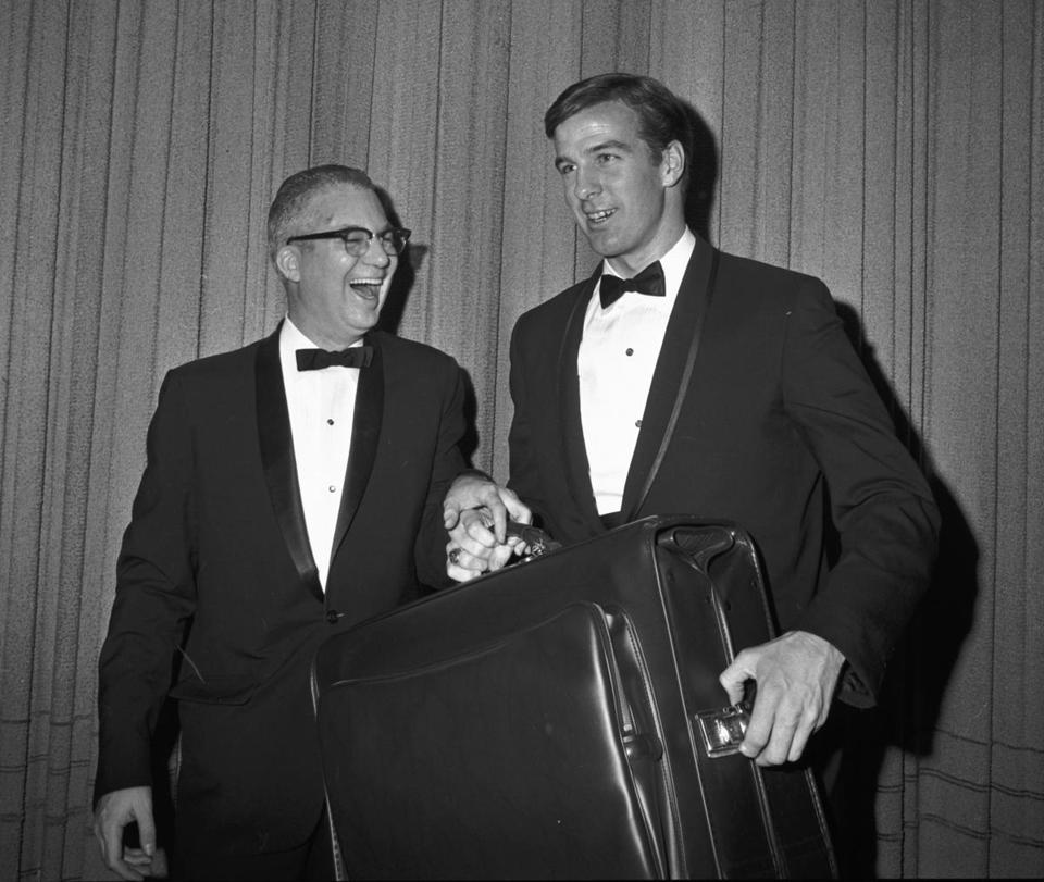 Dave O'Hara presented a traveling bag to Jim Lonborg after he was named American League pitcher of the previous season in 1968.