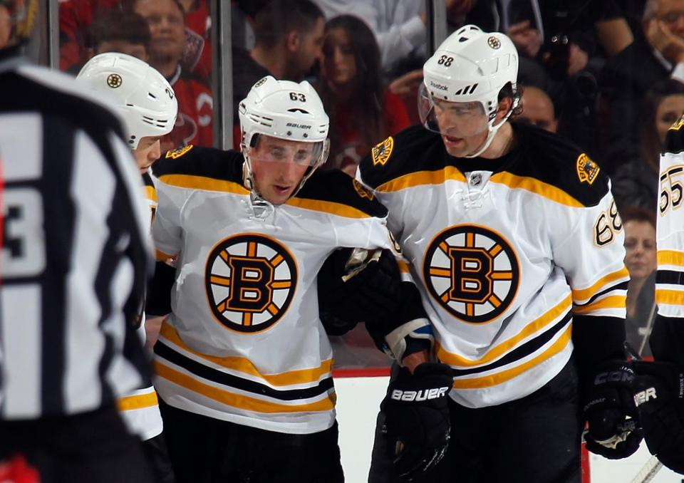 Brad Marchand was helped off the ice after being hit on Wednesday night.