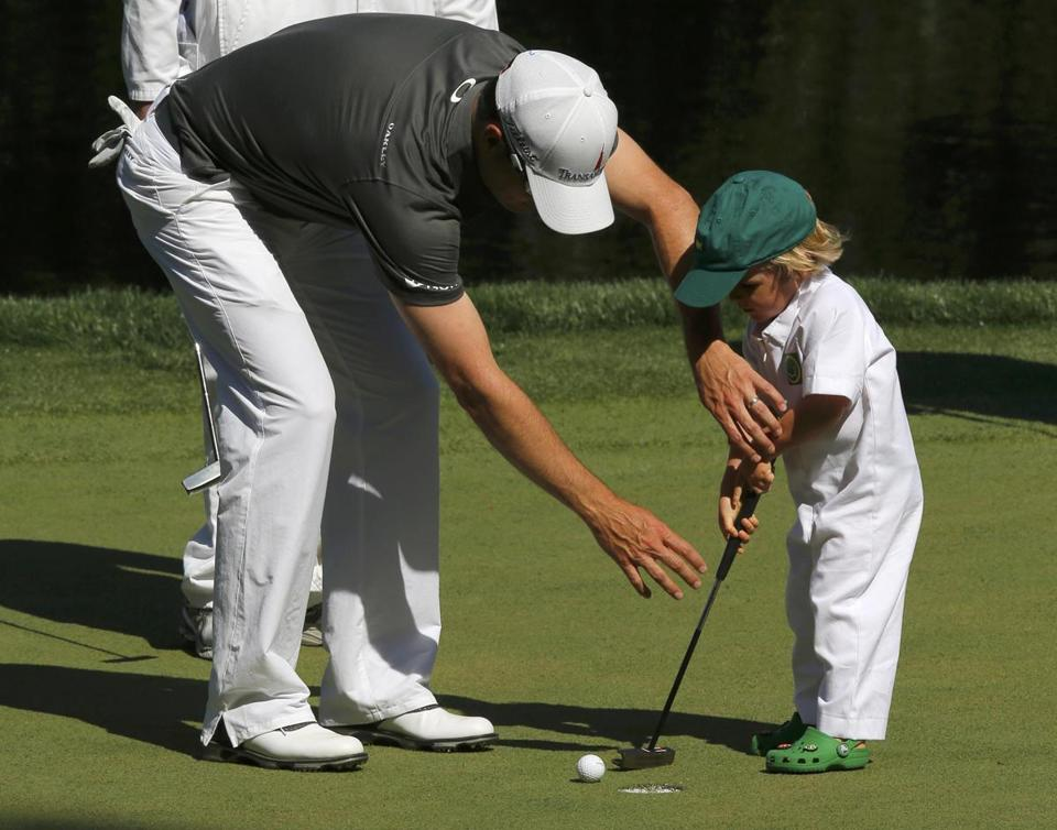 2007 Masters champion Zach Johonson offered some putting help to his child for this tap-in during Wednesday's Par-3 Contest at Augusta National. The season's first men's major begins Thursday.