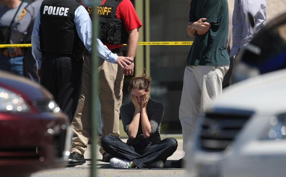 Clara Keller sat near police officers outside the New River Valley Mall in Christiansburg, Va., after the shootings.