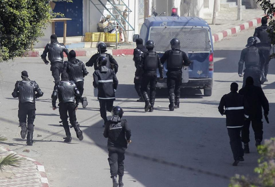 Tunisian riot police clashed with protesters in Hergla, about 60 miles south of Tunis, on Friday.