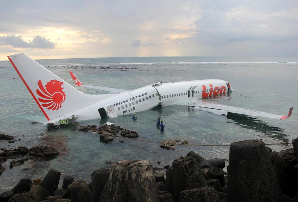 The Boeing 737 fell short of a runway while trying to land at Bali's international airport.
