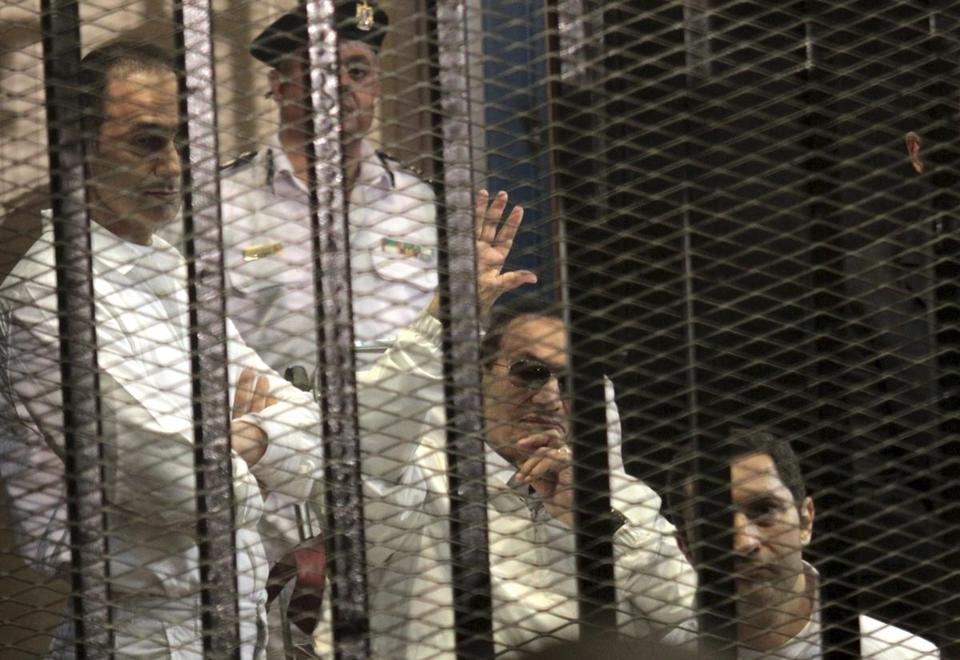 Egypt's ex-leader Hosni Mubarak, with sons Alaa (right) and Gamal, waved to supporters.