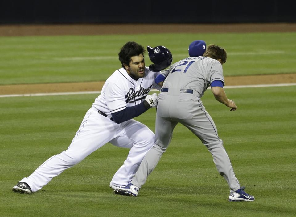 Padres outfielder Carlos Quentin tackled Dodgers pitcher Zack Greinke after a beaning.