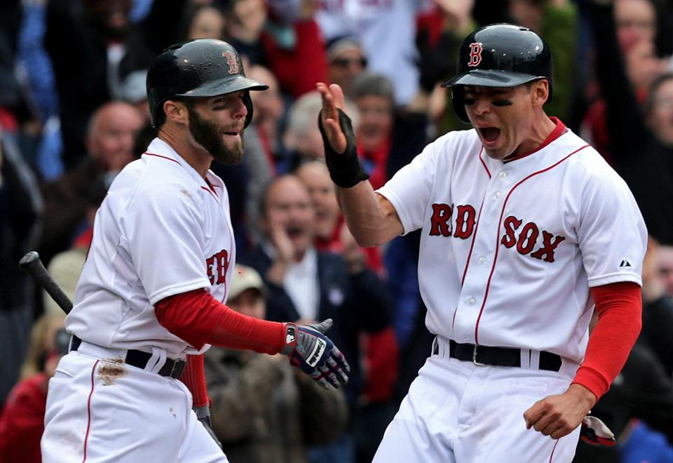 A jubilant Jacoby Ellsbury celebrated with Dustin Pedroia after scoring the winning run for the Red Sox on a single by Shane Victorino in the 10th inning.