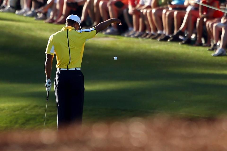 On the 15th hole in Round 2, Tiger Woods makes an illegal drop that a TV viewer  brought to the attention of officials.