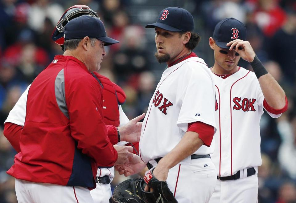 Red Sox manager John Farrell, left, took the ball from Joel Hanrahan after Hanrahan walked two batters in a game against the Rays Saturday.
