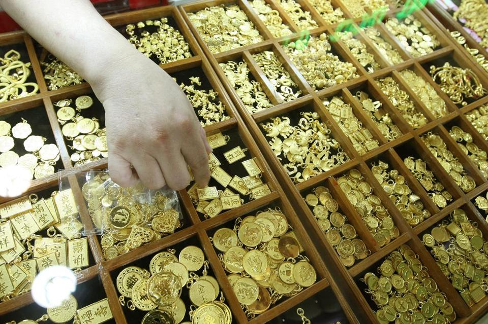 A gold shop in Bangkok. Gold is trading below $1,400 an ounce for the first time since February 2011.