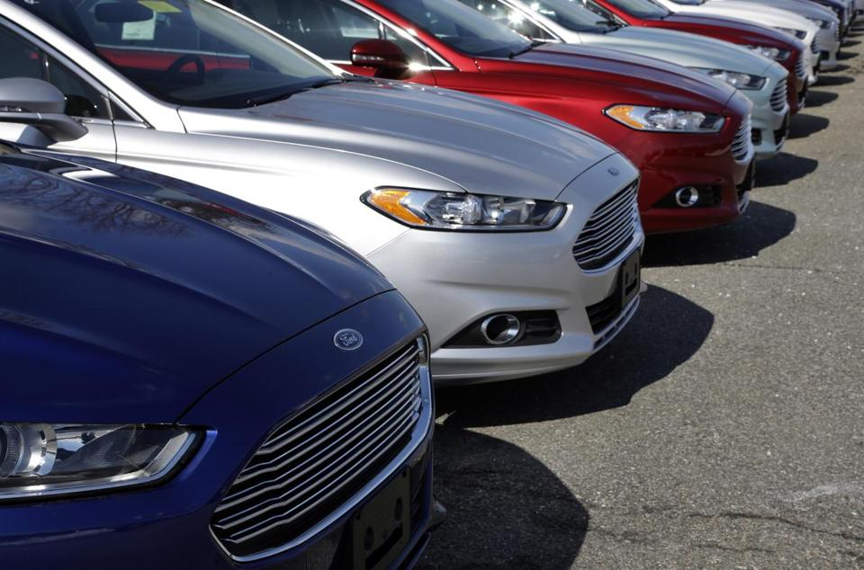Ford Fusion sedans at a Norwood Ford dealership. Ford and GM hope to save millions of dollars with the program.