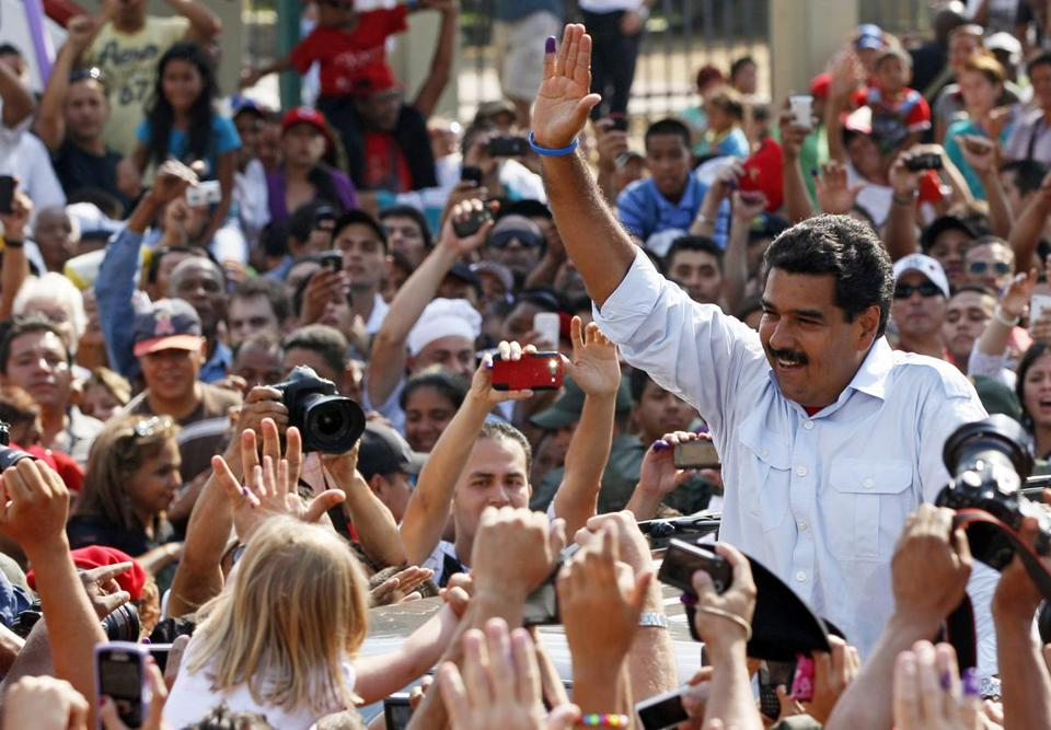 Nicolas Maduro, Venezuela's interim president, tied his campaign to the policies of Hugo Chavez, who died last month. Officials said he won 50.6 percent of the vote on Sunday.