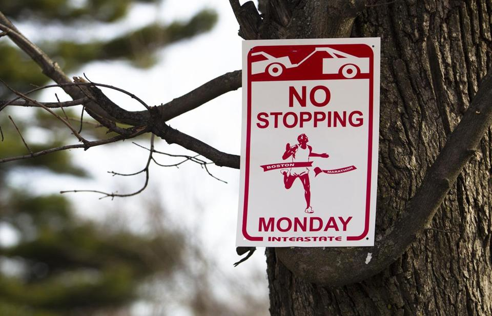 No parking and no stopping signs were ubiquitous in Hopkinton last Monday.