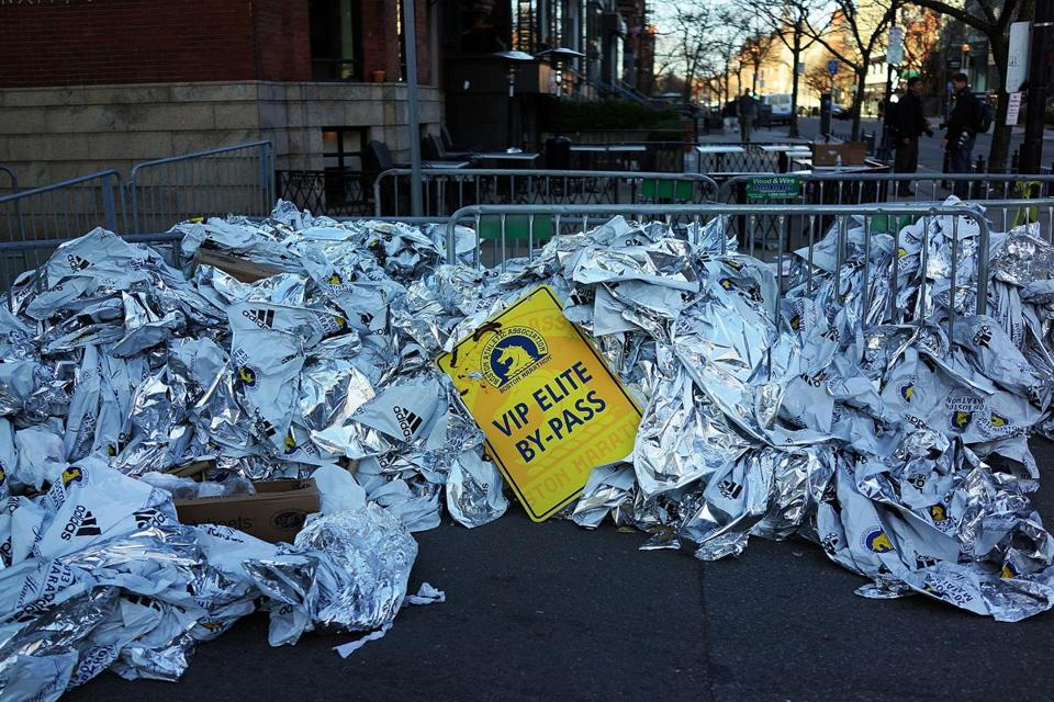 Unused thermal blankets for marathon participants were piled Tuesday near the scene of a twin bombing at the Boston Marathon.