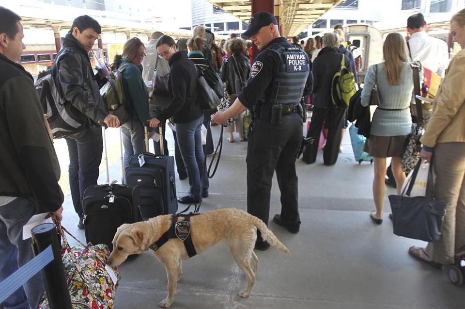 Amtrak police officer Joe Agnellino and his bomb detection dog checked passengers before they boarded a train at South Station Tuesday.
