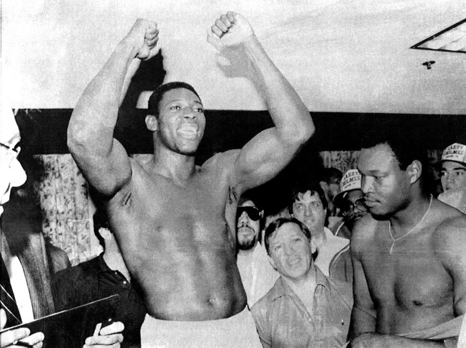 """He made a believer out of me,'' champion Larry Holmes (right) said of Carl Williams."