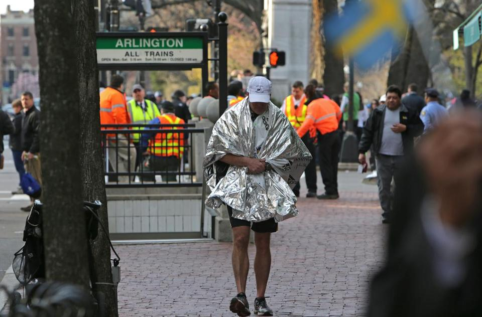 A runner walked away from Boston Common after marathoners were diverted following the explosions.