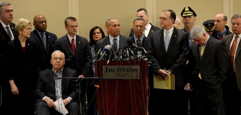 Governor Deval Patrick speaks during a press conference Tuesday with, from left, Boston Police Commissioner Ed Davis, Senator Elizabeth Warren, interim Senator Mo Cowan, Mayor Thomas Menino, FBI Special Agent in Charge Richard DesLauriers, US Attorney Carmen Ortiz, US Representative Stephen Lynch, ATF agent Gene Marquez, Massachusetts State Police Colonel Timothy Alben, and Suffolk County District Attorney Dan Conley.