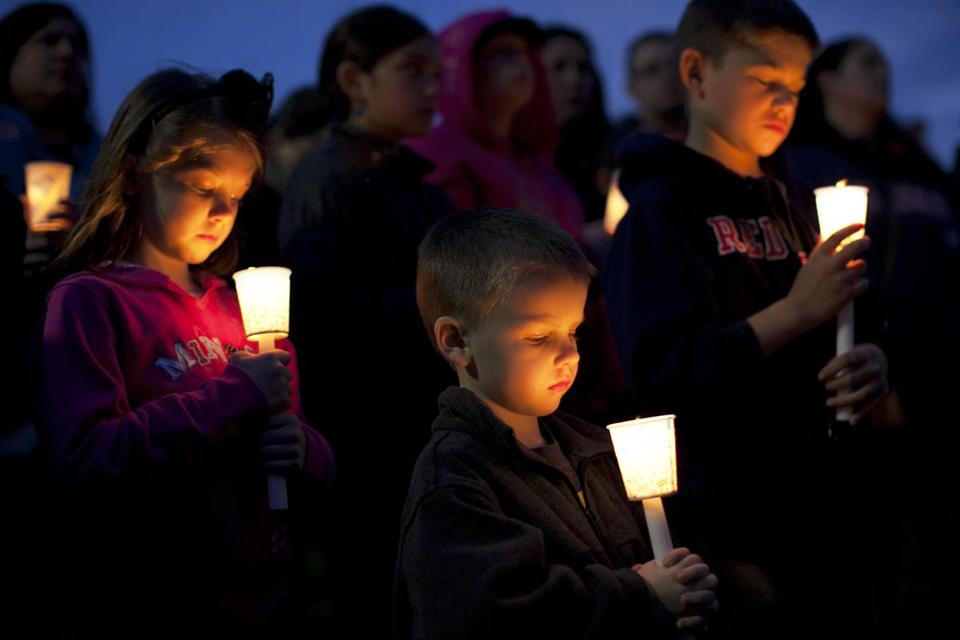 Emily Gillis, 7, brother Conor, 4, of Dorchester, and their cousin Benjamin McCormick, 8, of Milton were among those at a vigil Tuesday night at Garvey Park in Dorchester in memory of Martin William Richard, 8, killed in the bombings.