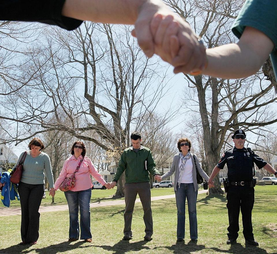 In Hopkinton, people held hands in a vigil near the Boston Marathon starting line Wednesday.