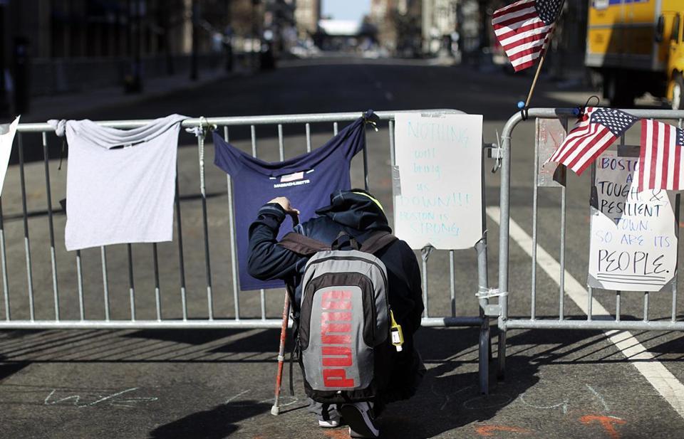 Robert Bakoian of Boston prayed at the barricade to the crime scene at Boylston and Berkeley streets on Wednesday.