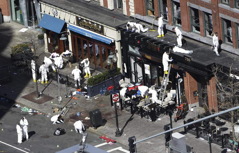 Investigators combed through the scene of one of the blast sites on Wednesday morning.