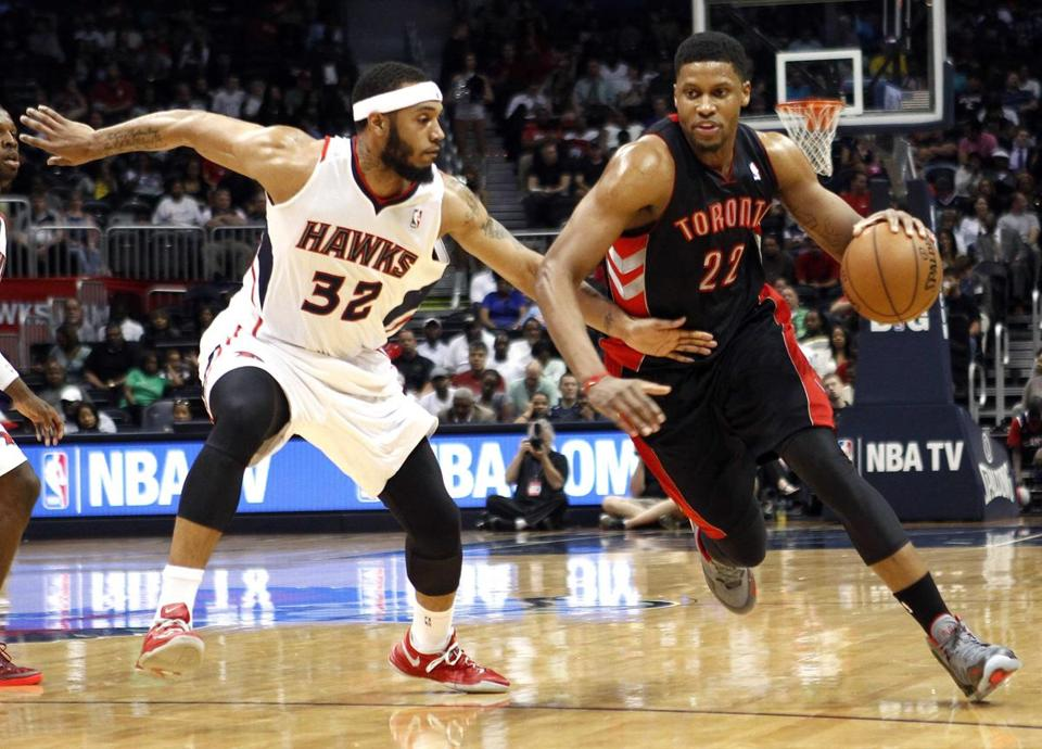 The Raptors' Rudy Gay (right), who scored 22 points, gets a step on the Hawks' Mike Scott in Toronto's one-sided victory.
