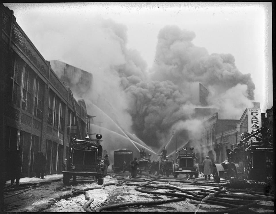 Images from the Boston Public Library available on the new database include a 1934 photo of a fire at Fenway Park and Babe Ruth in his Red Sox uniform from 1915.