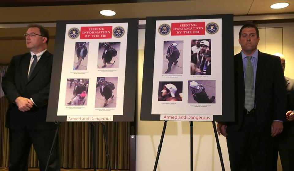 Photos of two people of interest were revealed during a press conference Thursday that included the key law enforcement officials investigating the Boston Marathon explosions that occurred on Monday.