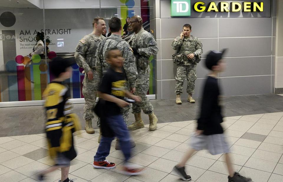 Fans walked past United States servicemen at the TD Garden, where the Bruins play the Buffalo Sabres.