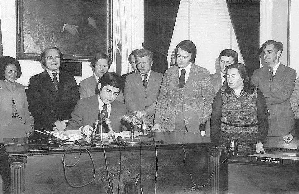 Edward Markey, with Governor Michael Dukakis signing the judicial reform bill Markey had championed.