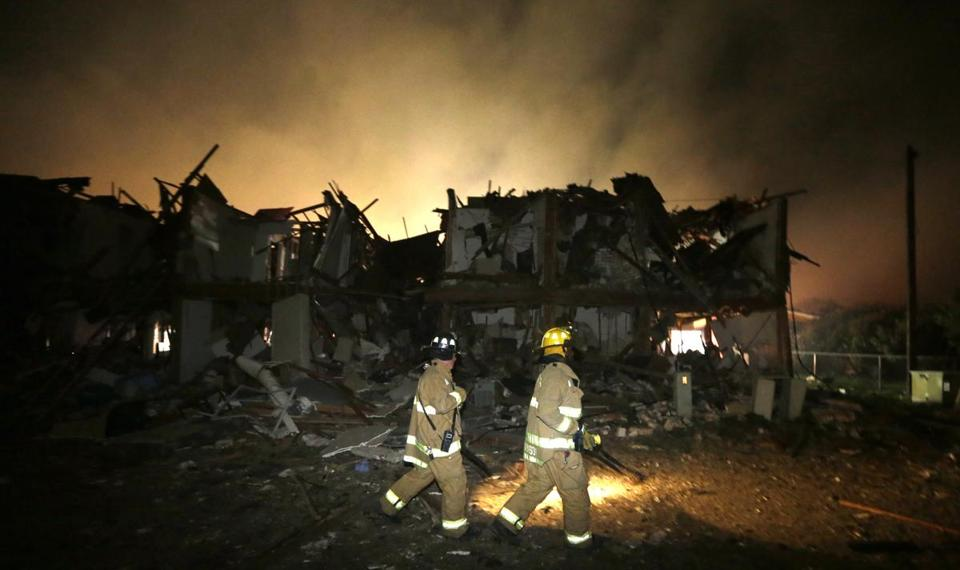 Firefighters checked a destroyed apartment complex near the fertilizer plant that exploded earlier in West, Texas, early Thursday.