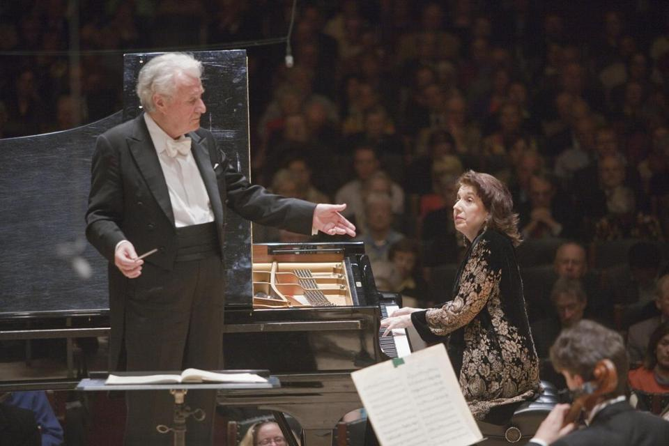 Colin Davis is shown leading the Boston Symphony Orchestra with pianist Imogen Cooper.