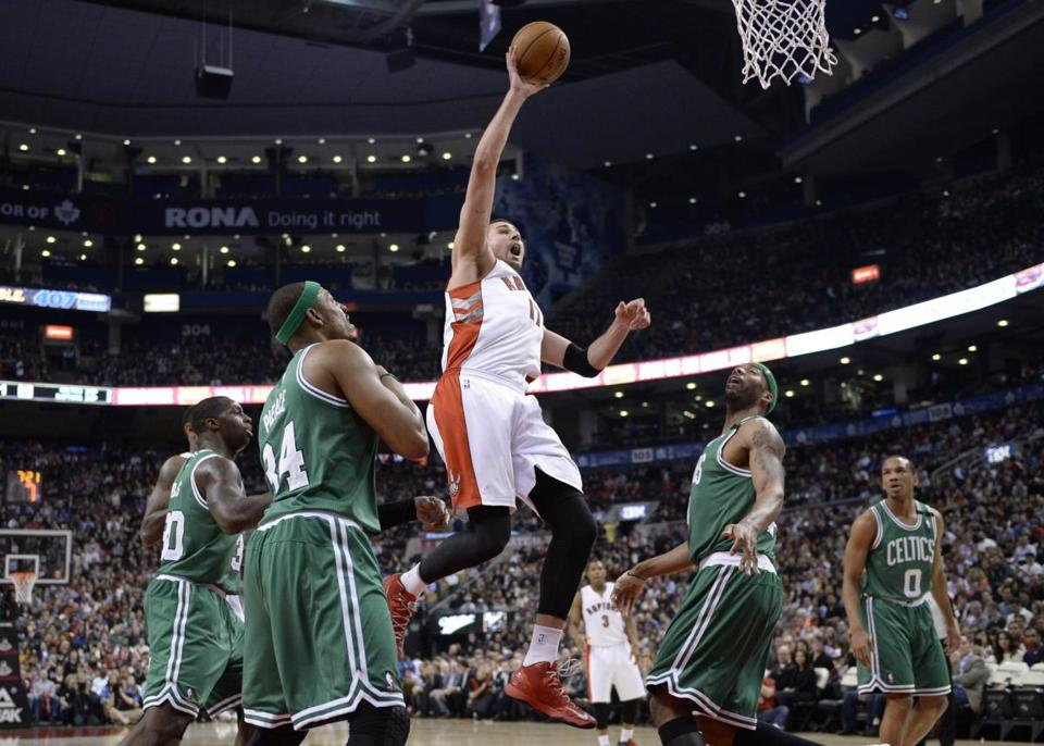 Raptors center Jonas Valanciunas drove to the basket in the first half.