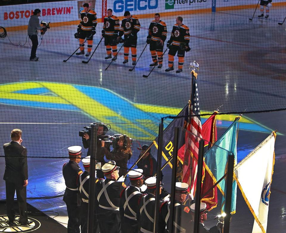 The Boston Fire Department took the Garden ice with Rene Rancourt for a poignant national anthem.