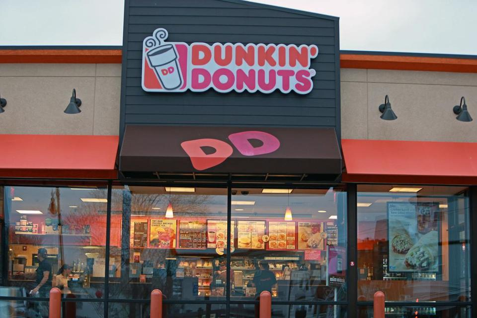 An open Dunkin' Donuts shop at the corner of Dorchester Avenue and Boston Street in Dorchester offered a welcome glow during the lock-down.