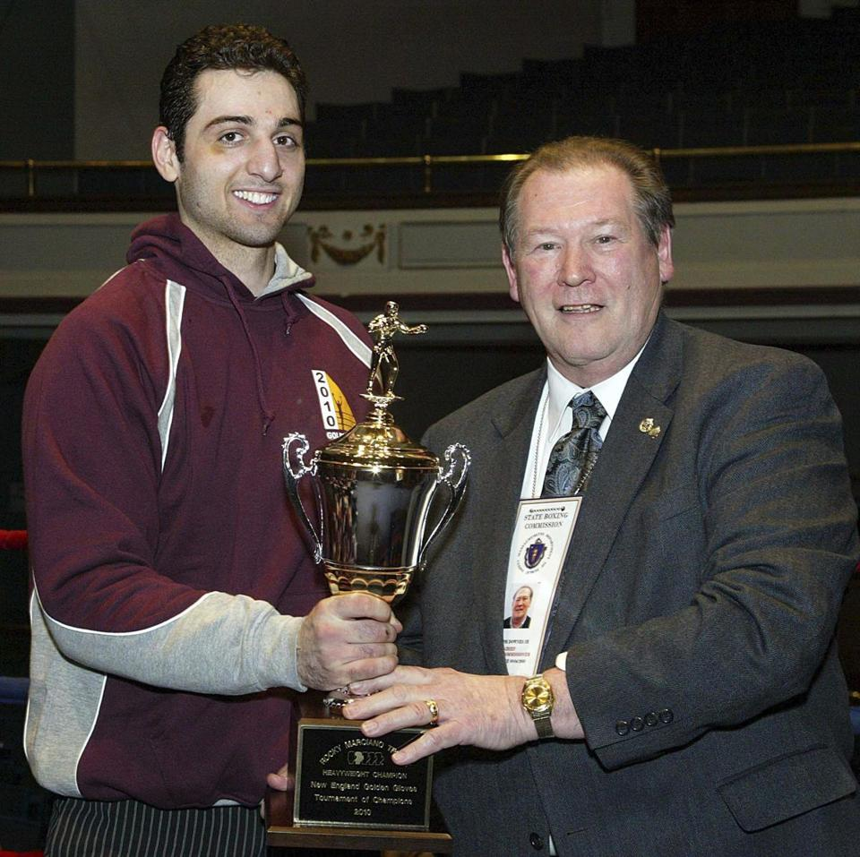 Tamerlan Tsarnaev (left) accepted the trophy for winning the 2010 New England Golden Gloves Championship in Lowell.