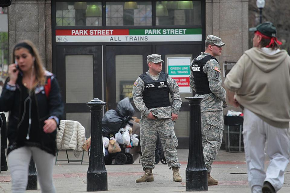 Military police stood guard outside the Park Street Station Friday after the entire public transit system was shut down.