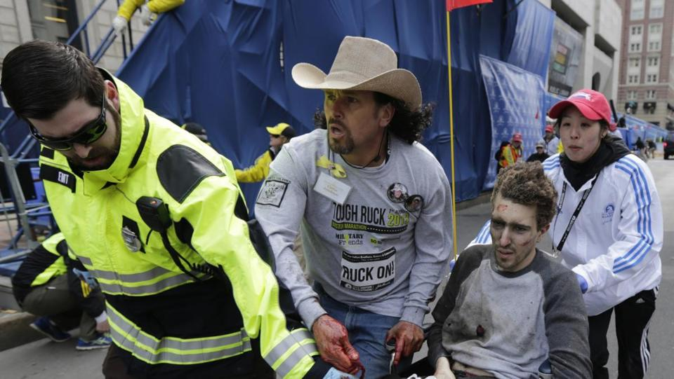 The photo of an emergency responder and volunteers, including Carlos Arredondo, who pushed an injured Jeff Bauman Jr., appeared on the BostonMarathonMassacre.com site.