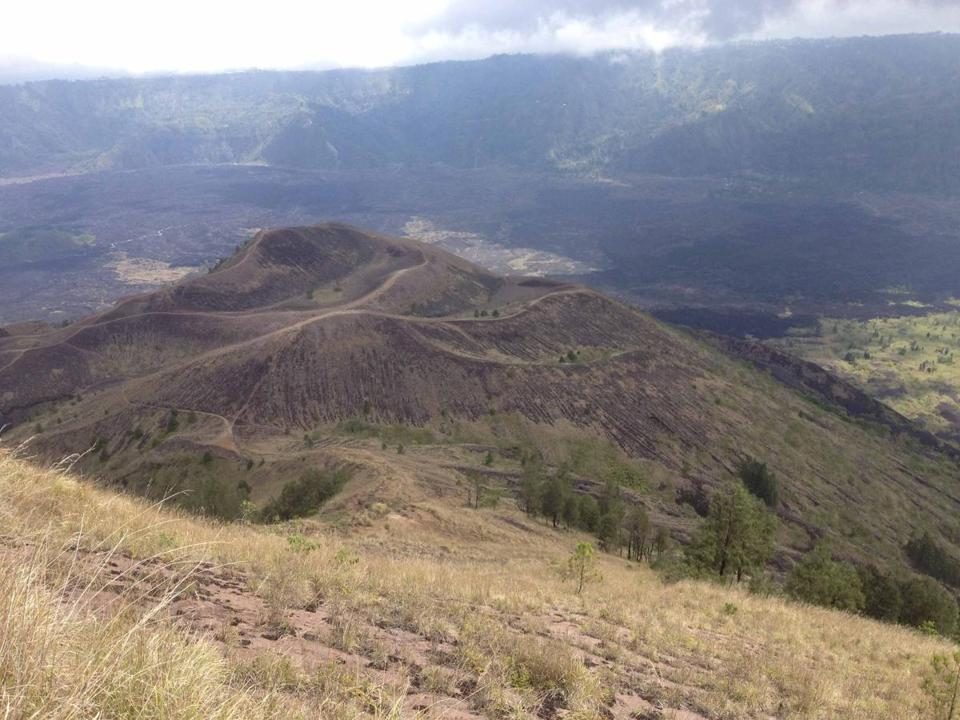 A view from the top of Mount Batur, looking toward the new craters and the charred land surrounding the volcano.