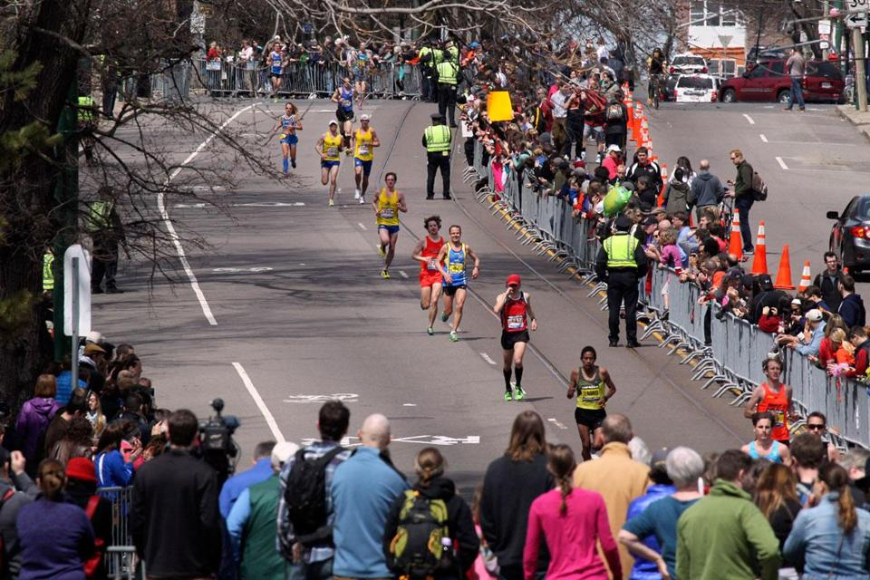 Spectators watched runners approach Cleveland Circle Monday before the explosions.